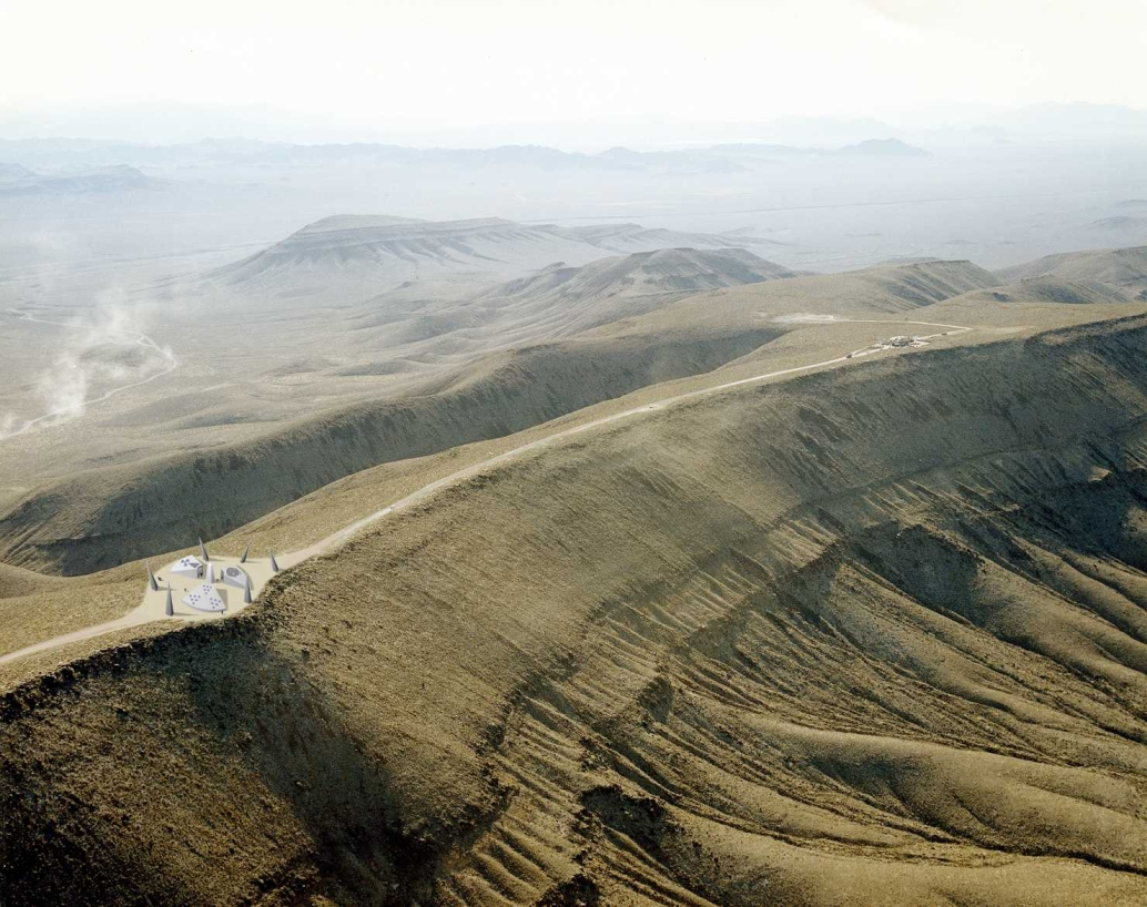 Yucca Mtn with artist's rendition of warning monument for future generations.jpg