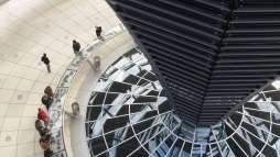 Double Duty: The cowl within the Bundestag's glass dome provides both natural ventilation and lighting to the assembly hall below
