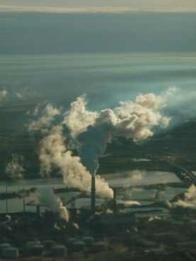 Looking Down: An aerial view of the open-pit tar/oil sands mines and upgrading plants outside Fort McMurray, Alberta