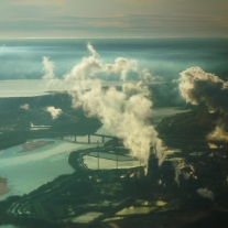 Foul Air: An aerial view of the open-pit tar/oil sands mines and upgrading plants outside Fort McMurray, Alberta