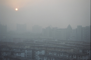 Smothered: A rising sun struggles to pierce the sooty air that hangs over Jinhua, a city of 1 million residents southwest of Shanghai