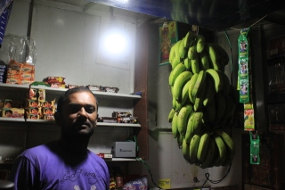 Bangalore street vendor with battery-powered light SOURCE IBM Research India