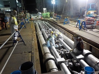 Readying refrigeration lines at Fukushima to create a 30-meter-deep frozen barrier against groundwater